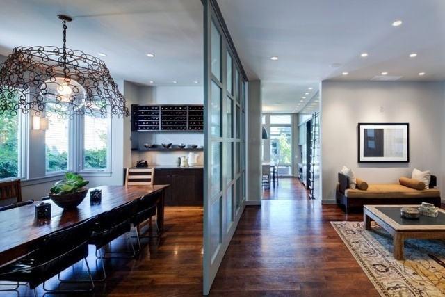 窗簾隔斷是最簡單,最有效的一種客廳與餐廳隔斷方式,可以采用布簾