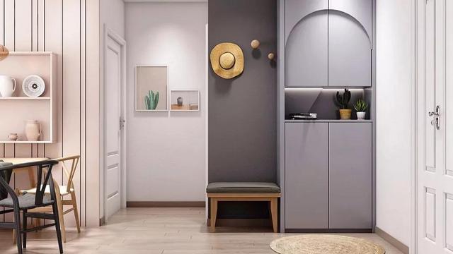 卡座式壁柜 时下流行的卡座设计,也可以被完美地运用到开放式壁橱中。 这种样式的柜子一般设计在靠窗位置,中间部分留空,用来悬挂衣服、包包、帽子、运动器材等出门常用的物品,也方便坐着换鞋和享受惬意的休闲时刻。   柜子的内部收纳空间,可以不必设计成中规中矩的样式,将悬挂区、吊柜、矮柜、抽屉、隔层等多种元素组合起来,收纳方式更灵活,也大大丰富了空间的层次。  在留空区域安装几个挂钩,外套、帽子、包包等都有了合适的藏身之处,进出门的时候就再也不用跑到别的房间,轻松省事多了。